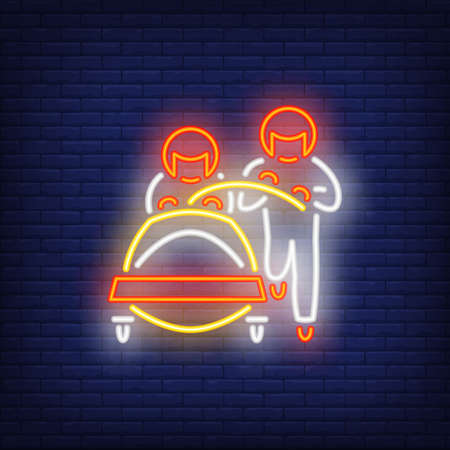 Two bobsledders neon sign. Glowing sportsmen and bob on dark blue brick background. Can be used for sport, winter game Reklamní fotografie