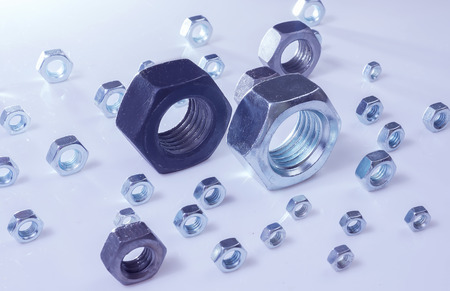 chromeplated: steel chromeplated nuts on reflecting surface
