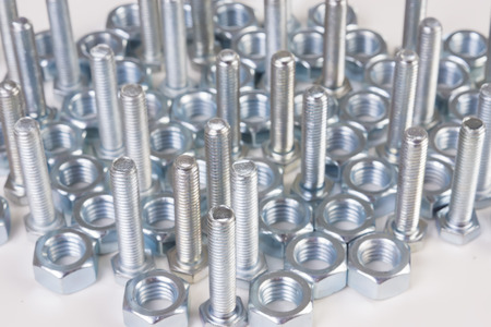 steel chromeplated bolts on white background photo