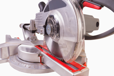 crosscut: gray circular saw on white background