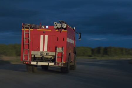a fire truck rides on the highway