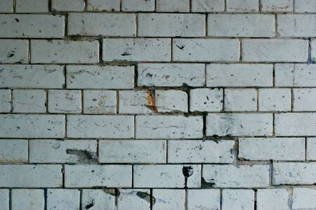 mortal: grunge white brick wall