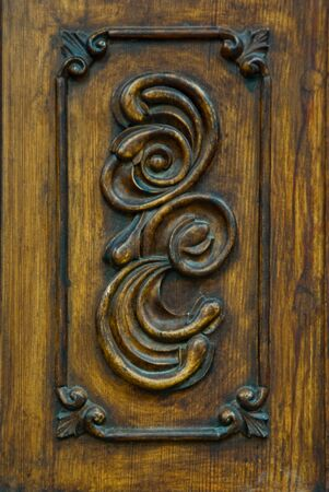 wooden door carved detail close up photo