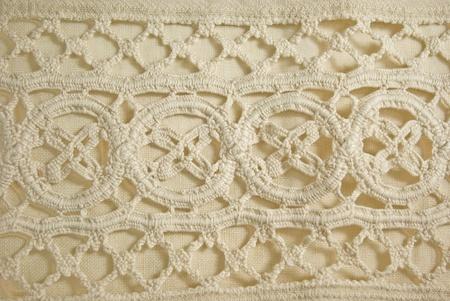 detail of vintage crochet lace linen background photo