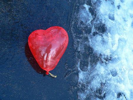 Heart air balloon on the snow
