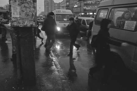 People running to bus. Black and white