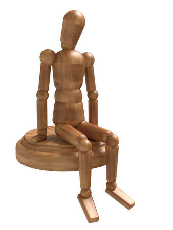 Sitting wooden figure. Isolated on white photo