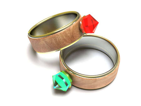 Two golden rings with colored brilliants