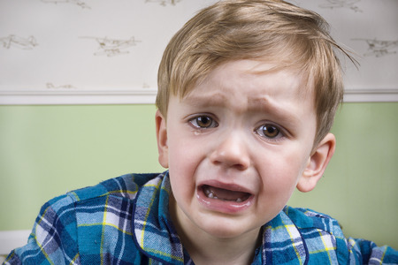 Small boy crying dramatically before bedtime
