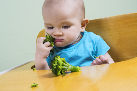 steam mouth: Funny baby tasting broccoli