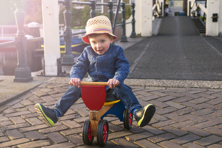 cute little boy riding his tricycle Stock Photo