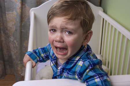 sad face: little boy crying hysterically Stock Photo