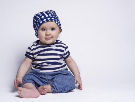 귀여운 옷에 웃는 아기 스톡 콘텐츠