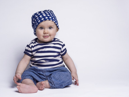 Smiling baby in cute outfit Stock Photo