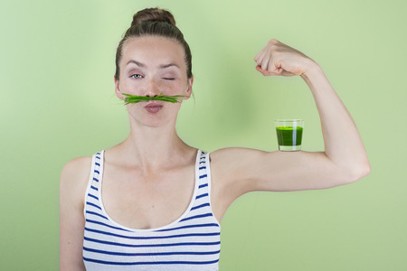 Fit and strong with wheat grass juice Stock Photo