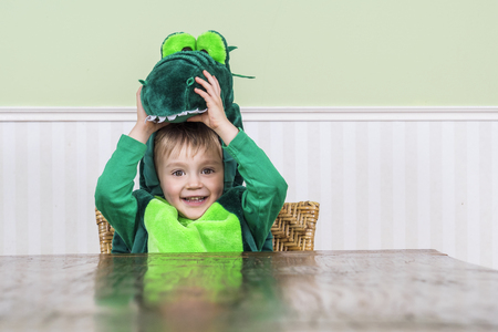 Cute child wearing a crocodile costume Stock Photo