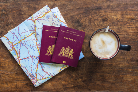 Top view of a couple of European passports and coffee