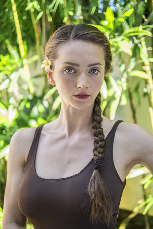 Portrait of a young lady in a tropical resort Stock Photo