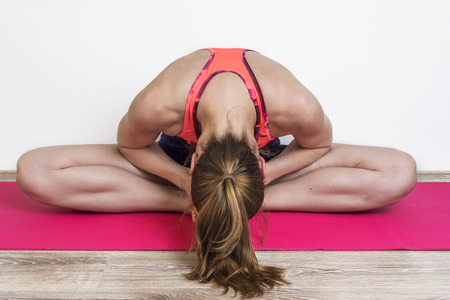 Young woman practicing yoga poses at home