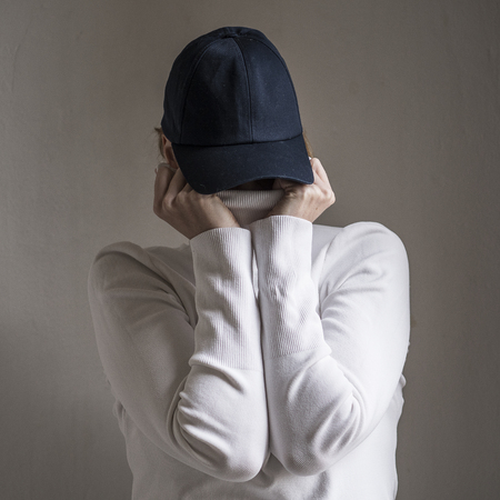 Lady hiding her face Stock Photo