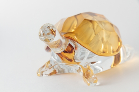 Transparent yellow glass turtle isolated on white background