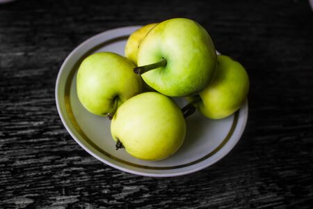 Green apples on plate