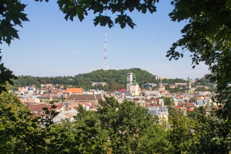 Lviv city center panorama with leaf of trees frame Stock Photo