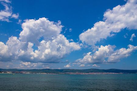 big white clouds clouds above blue sea water photo