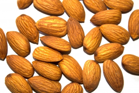 brown almonds on white background Stock Photo - 16858717