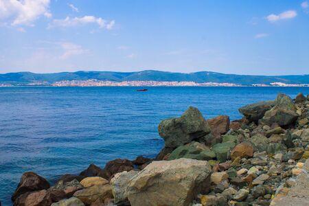 stones near sea photo