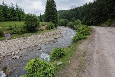 River in Carpathian mountains village Stock Photo