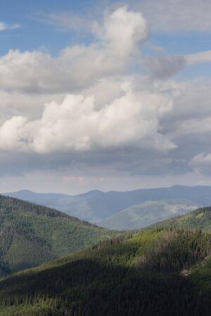 blue cloudy sky over mountains range Stock Photo