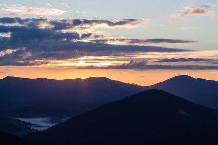 sunset sky over mountains range