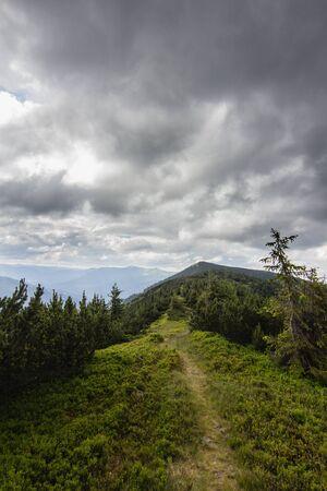 path on summer mountains range