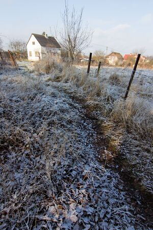 winter landscape of house in village in snow