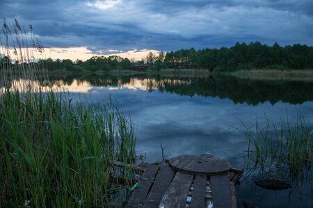 Beautiful twilight landscape over small rural lake