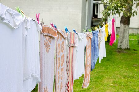 Colorful laundry hanging on rope in summer garden in typical countryside village in Ukraine