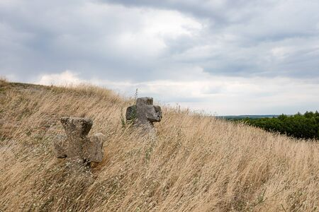 view on Pidkamin inselberg on adjacent hill and nearby ancient graveyard in Brody region of Galychyna, Ukraine