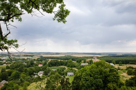 Scenic view on Pidkamin inselberg on adjacent hill and nearby village in Brody region of Galychyna, Ukraine Stock fotó