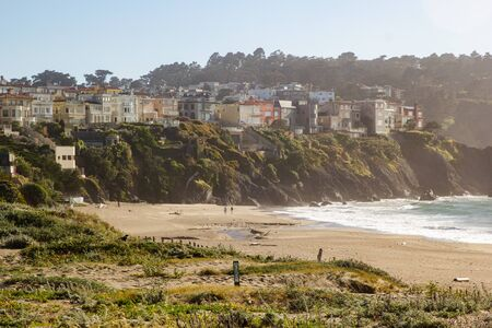 Scenic view on coastal houses on cliffs near Pacific Ocean in San Francisco, view from Baker Beach