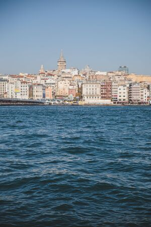 Old Istanbul city skyline with harbor water waves and clear clue sky background, cityscape view on Galata tower, Karakoy district and Golden Horn in Turkey Archivio Fotografico - 150249348
