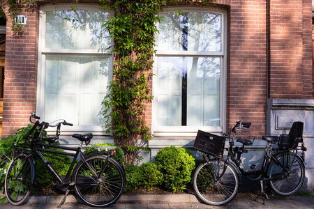 Bicycles on empty streets of Amsterdam in morning light