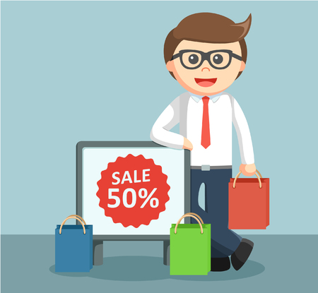 businessman standing: businessman standing beside a sign of discounts