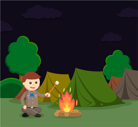 cross legged: boy scout roasting marshmallow at camping site