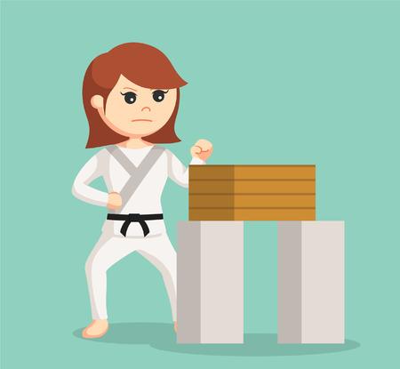 women sport: karate woman doing breaking boards technique