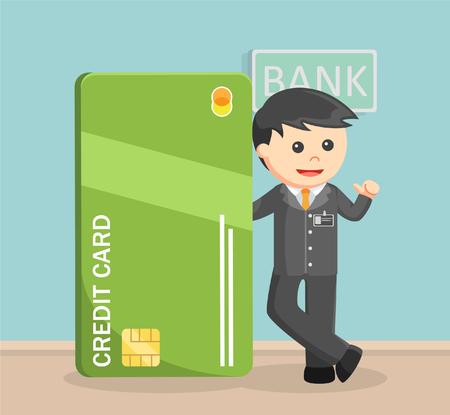 beside: Bank teller standing beside giant credit card