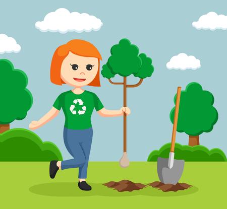 planting tree: Woman environmental activist planting tree