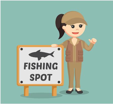 beside: fisher woman standing beside fishing spot sign