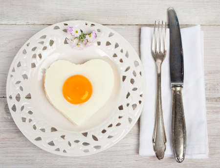 sunnyside: Heart shaped fried egg on beautiful plate