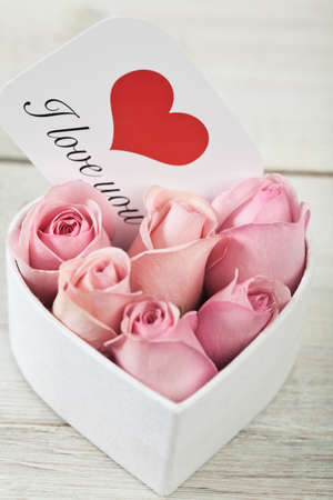 Pink roses with a card written saying love you Stock Photo - 4272483